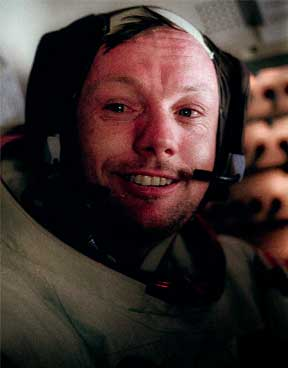 Neil Armstrong with his helmet removed, but still in his dust-covered suit inside the LM.